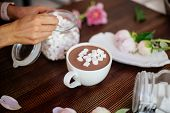 Hot Cocoa With Marshmallow On A Table With Peony Flowers. Flatlay. poster