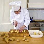 image of chef knife  - A chef preparing a potato dish - JPG