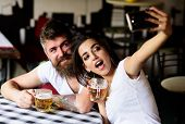 Take Selfie Photo To Remember Great Date In Pub. Couple In Love On Date Drinks Beer. Best Friends Or poster
