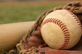 stock photo of baseball bat  - Baseball in a Glove on the field - JPG
