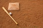 Baseball & Bat in the Infield Dirt with room for copy