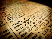 pic of pronunciation  - Definition of debt in dictionary book on pages with type - JPG