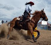 foto of barrel racing  - Cowgirl competing in the barrel race - JPG