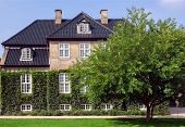 Garden Around The Beautiful Brick Walls Of Historical House In Copenhagen, Denmark. Traditional Arch poster