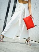 Unrecognizable Fashionable Woman Wearing High Fashion Fashionable Outfit Showing Red Purse Bag poster