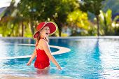 Child With Hat In Swimming Pool. Tropical Vacation poster