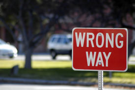 picture of warning-signs  - Red street sign stating wrong way direction - JPG