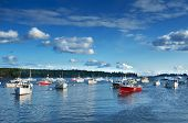 picture of lobster boat  - Quaint New England fishing harbor on the Maine coast - JPG