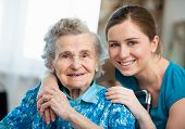 image of responsibility  - Senior woman with her caregiver at home - JPG