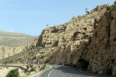 stock photo of zoroastrianism  - Road near ruins of zoroastrian temple Qal - JPG