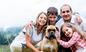 picture of family bonding  - Happy family with a dog enjoying the countryside lifestyle - JPG