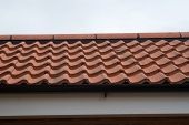 foto of soffit  - Photo of a modern tiled roof with soffits - JPG