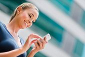 stock photo of sms  - Business woman using app on a smart phone - JPG
