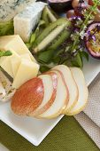 image of fruit platter  - Delicious fruit and cheese platter featuring sliced pear and a variety of different cheeses and fresh fruits - JPG