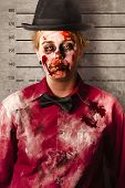 image of gruesome  - Police criminal mug shot of a female monster with busted up face standing on height record chart - JPG