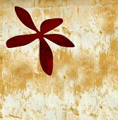 image of droopy  - A dirty red and wild oriental inspired flower on a golden brown textured gunge background - JPG