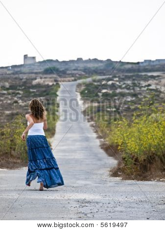or Photo of Lonely woman in middle of nowhere running away in fearRunning Away In Fear