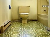 stock photo of linoleum  - Bathroom designed in hideous green and yellow 70s style in desperate need of a makeover and updates.