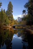 image of granite dome  - Fall view of Merced River Half Dome and Sentinel Bridge Yosemite Valley - JPG