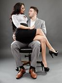 stock photo of office romance  - Sexy secretary sitting on the boss lap - JPG
