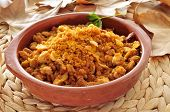 an earthenware bowl with migas, a traditional dish in the spanish cuisine made with breadcrumbs
