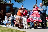 Senior Citizens Square Dance At Outdoor Event