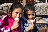 DAHAB - JANUARY 23. Local bedouin kids enjoying the pleasures of the western culture in Dahab, Egypt