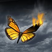 foto of heartbreaking  - Creative crisis business concept as a monarch butterfly in distress with a burning wing as a metaphor for problems in creativity and managing human sadness and depression - JPG