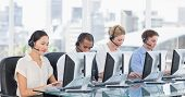 foto of half-dressed  - Group of business colleagues with headsets using computers at office desk - JPG