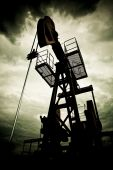 picture of nonrenewable  - Oil pumps in the fields vintage rusty colour against moody cloudscape