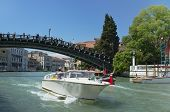 Venice, Veneto, Italy - May 24: Taxi boat driving under Ponte dell'Accademia bridge on Grand Canal.