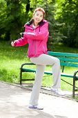 stock photo of mongolian  - Mongolian woman during morning training in a park - JPG