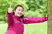 picture of mongolian  - Horizontal view of a mongolian woman doing sport - JPG