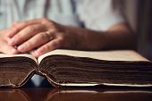pic of bible verses  - Male hands on 150 year old Bible