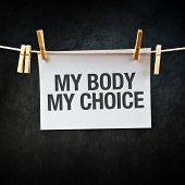 image of clotheslines  - My Body My Choice message printed on apper hanging on clothesline - JPG