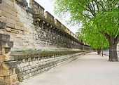 stock photo of avignon  - Ramparts still encircle Avignon and they are one of the finest examples of medieval fortification in existence.