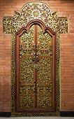 stock photo of fussy  - Gold plated fretwork on a door of an exclusive hotel in Asia  - JPG