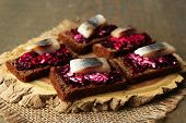 picture of canapes  - Canape herring with beets on rye toasts - JPG
