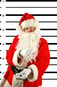 stock photo of delinquency  - Santa was arrested for being a Bad Boy after getting drunk on elderberry wine left out by the elves - JPG