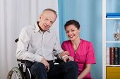 picture of hospice  - Disabled man and his nurse in a hospice - JPG