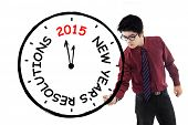 pic of start over  - Asian Businessman make clock for his resolution time in 2015 isolated over white background - JPG