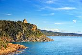 foto of leghorn  - Cliff rock and building on the sea on sunset - JPG