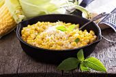 stock photo of grating  - Creamy corn with cream and grated parmesan - JPG
