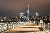 stock photo of freedom tower  - New York City Manhattan skyline over Hudson River viewed from New Jersey piers  - JPG
