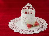 stock photo of doilies  - Vintage Christmas lantern with a bow - JPG