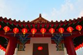 stock photo of mid autumn  - Red lanterns hanging on a Chinese Gazebo roof tile - JPG