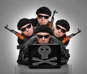 picture of terrorist  - Group of terrorists with laptop and weapons - JPG