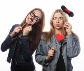 stock photo of two women taking cell phone  - Party image - JPG