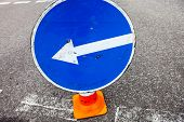 image of turn-up  - Turn left sign on the traffic cone - JPG