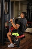 picture of lats  - Young man doing lats pull - JPG